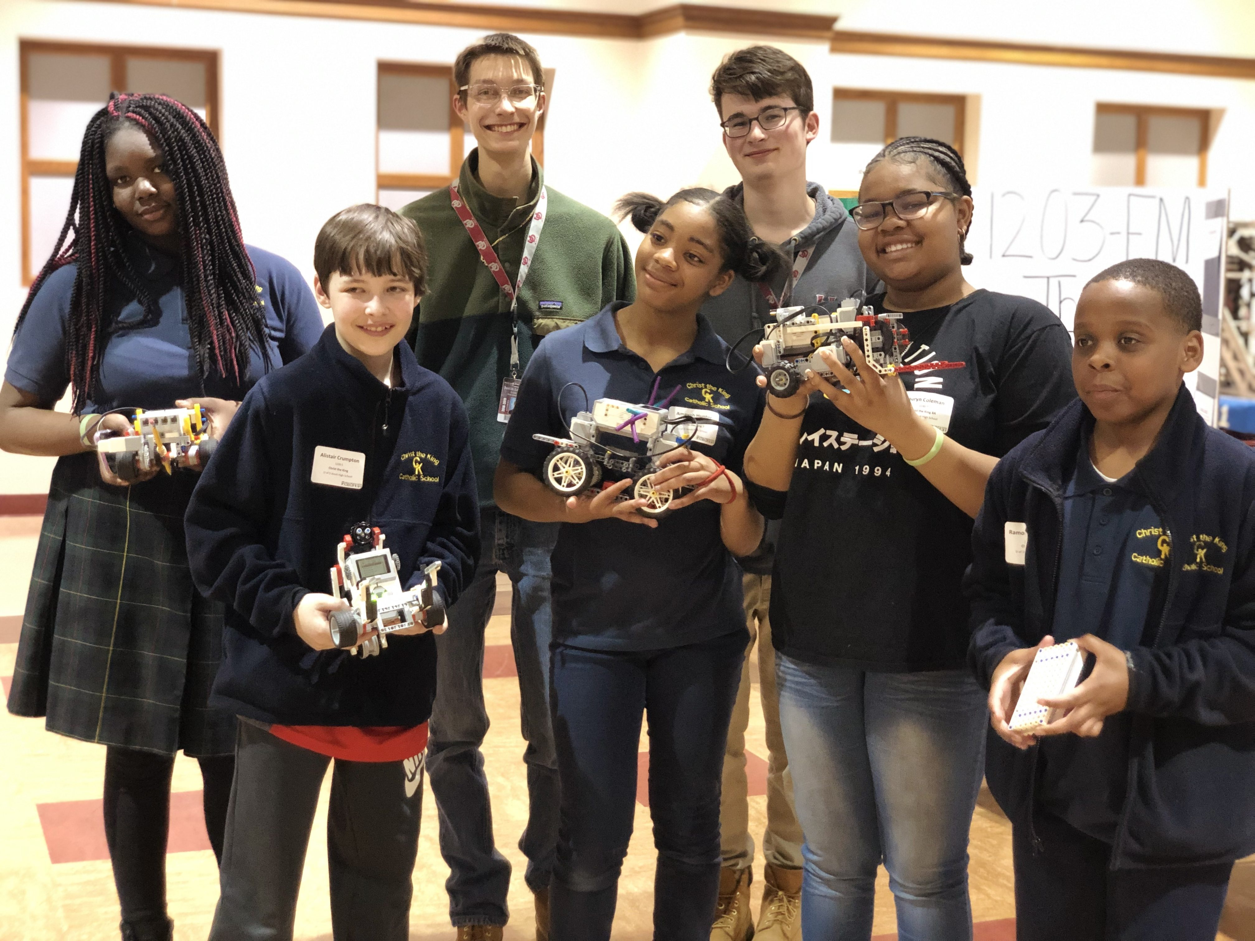 Winning robotics teams showing off their robots