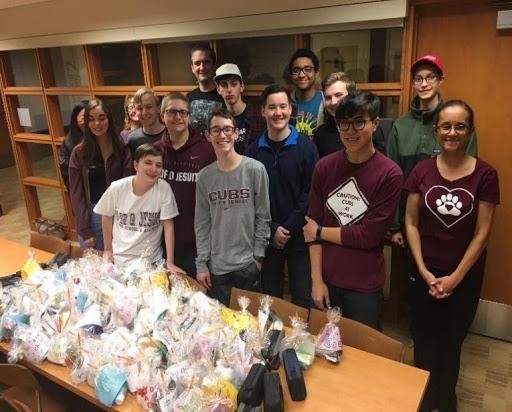 Students organizing toiletries and supplies for schools